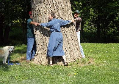 Group of people hugging a huge tree on the greenway Luray VA